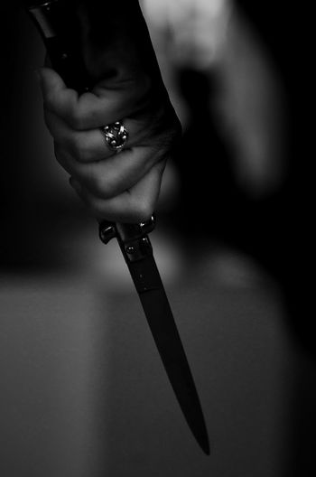 Cropped of woman holding knife