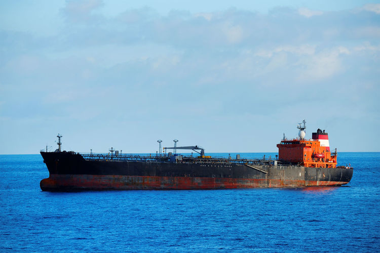 Barge on sea against sky