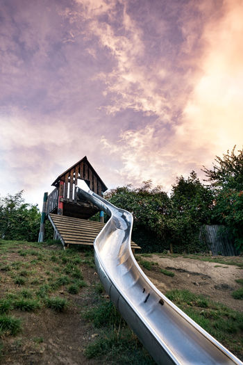 Slide At Park Against Cloudy Sky