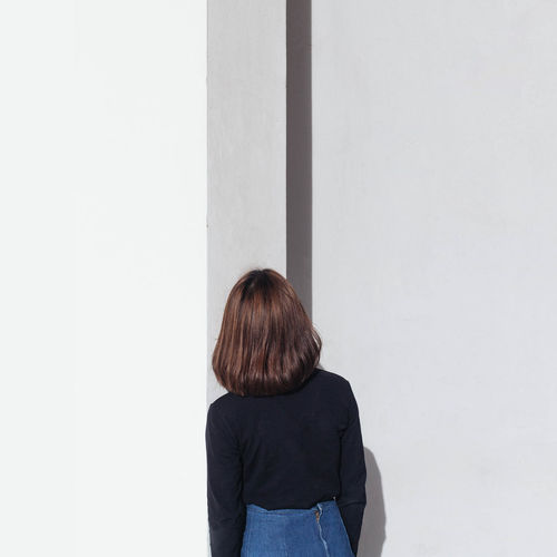 minimalism woman standing in front of the wall Alone EyeEm Best Shots EyeEm Gallery Lonely Adult Backgrounds Black Blond Hair Day Hipster Indoors  Lifestyles Minimalism One Person People Real People Rear View Shirt Standing White Women
