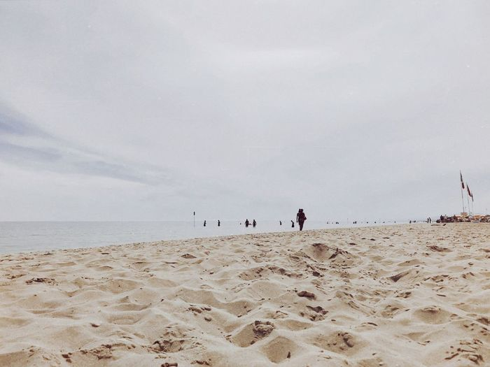 no more heroes Land Beach Sand Sea Sky Water Scenics - Nature Horizon Over Water Beauty In Nature Horizon Group Of People Real People Incidental People Cloud - Sky Leisure Activity Outdoors Holiday