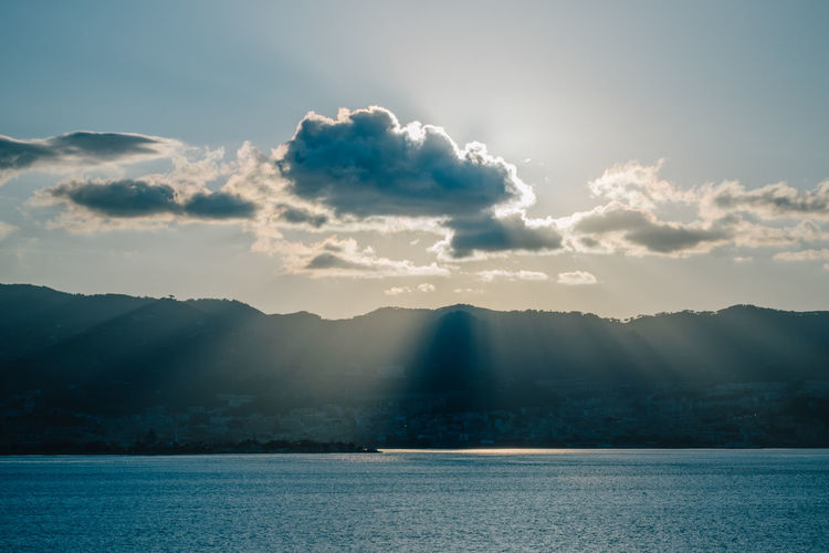 Clouds casting god rays on a diffused silhouette of Messina, Italy Beauty In Nature Cloud - Sky Day Diffuse Dimmed God Rays Messina Mountain Nature No People Outdoors Scenics Sea Sizily Sky Street Of Messina Sunlight Touristic Destination Tranquil Scene Tranquility Water Waterfront