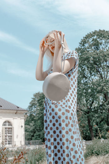 One Person Real People Leisure Activity Casual Clothing Nature Beautiful Woman Hairstyle Blue Sky Leather Bag Accessories Polka Dot Polka Dot Dress Editorial  Fashion Editorial The Week on EyeEm TheWeekOnEyeEM