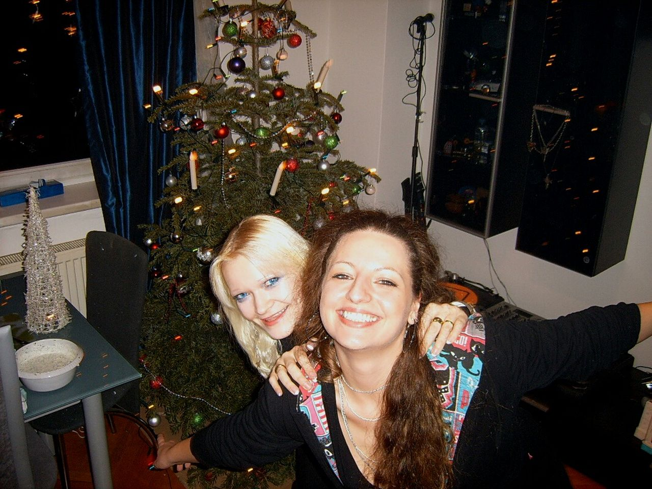 two people, indoors, christmas, front view, christmas tree, celebration, togetherness, smiling, night, real people, blond hair, looking at camera, friendship, technology, young adult, people