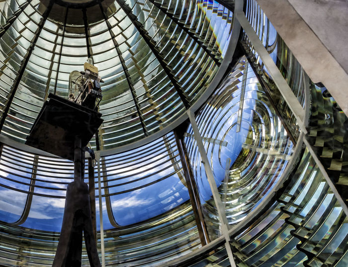 Reflections from the Fresnel lens of a lighthouse Mirror Architecture Building Exterior Built Structure Colorful Day Fresnel Geometry Indoors  Industry Low Angle View Modern Parallel Sky Working