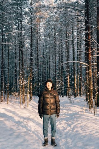 Full Length Of Man Standing On Field During Winter