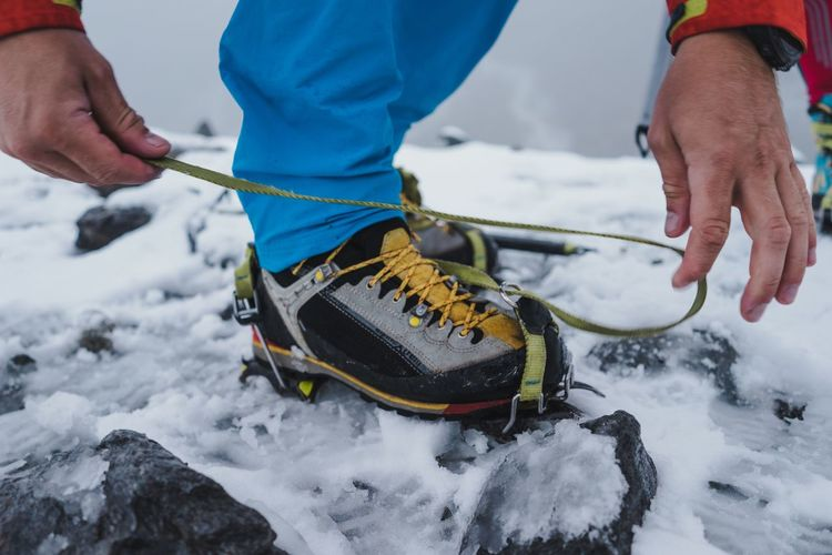 Putting on crampons Climbing Hiking Hike Moutain Glacier Ice Crampons Snow Winter Cold Temperature Human Hand Real People Human Body Part Day Outdoors Close-up Low Section Men People Nature