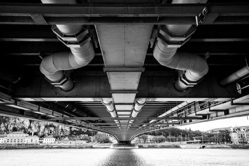 Digital composite image of bridge over river against building