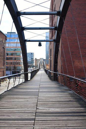 Empty footbridge against clear sky