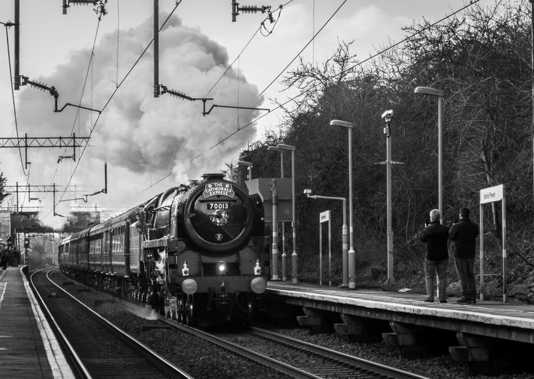 The Oliver Cromwell on its way to Norwich Steam Day Mode Of Transport Outdoors Public Transportation Rail Transportation Railroad Track Real People Sky Steam Train Train Train - Vehicle Train Station Transportation Tree