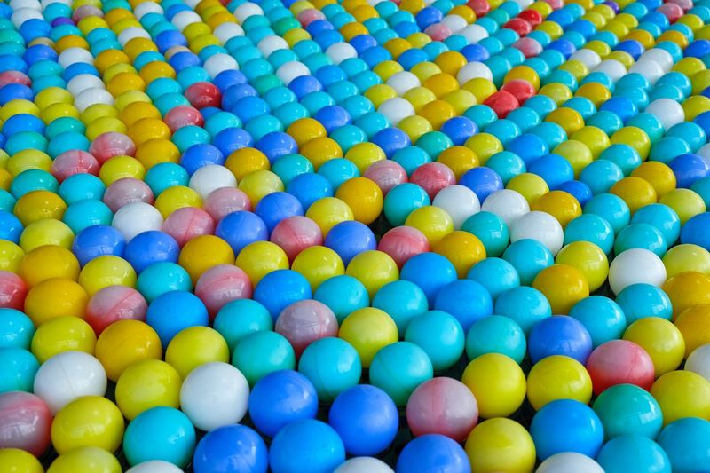 Childhood Colorful Bright Colors Floating Balls Ball Multi Colored Large Group Of Objects Backgrounds No People Variation Choice Still Life Indoors  High Angle View Selective Focus Shape