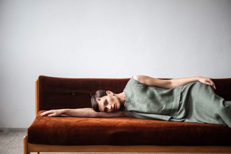 Portrait of woman resting on sofa