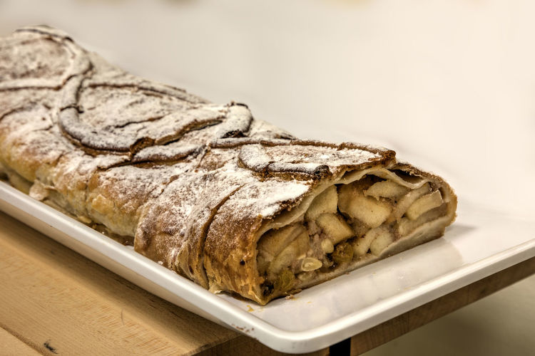 Apple strudel pie with flakey crust and firm apples flavored with cinnamon. Food And Drink Food Indoors  Close-up Freshness No People Studio Shot Plate Wellbeing Ready-to-eat Focus On Foreground Indulgence Baked Tray Temptation Apple Strudel Strudel Pie Dessert Sweet Bakery Tart Dessert Tart Apple Apple Desserts