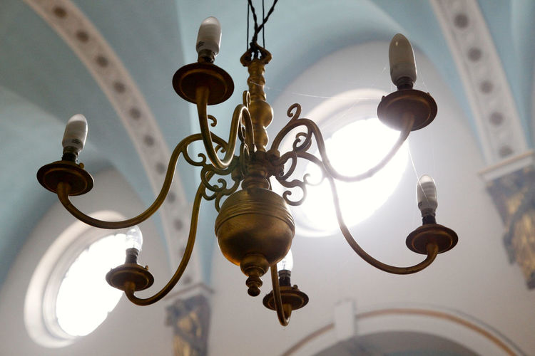 Low angle view of chandelier in brightly lit church