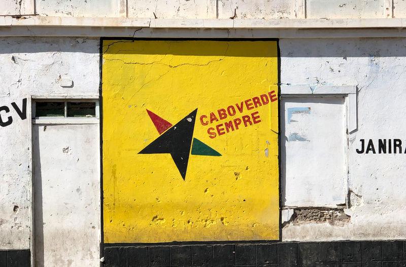 Mural in Espargos, Sal Island, Cabo Verde Yellow Communication Building Exterior Mural Art