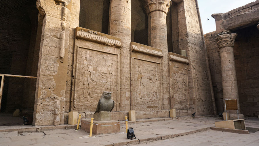 Temple of horus edfu columns and structure around corridor and entrance with hieroglyphic details