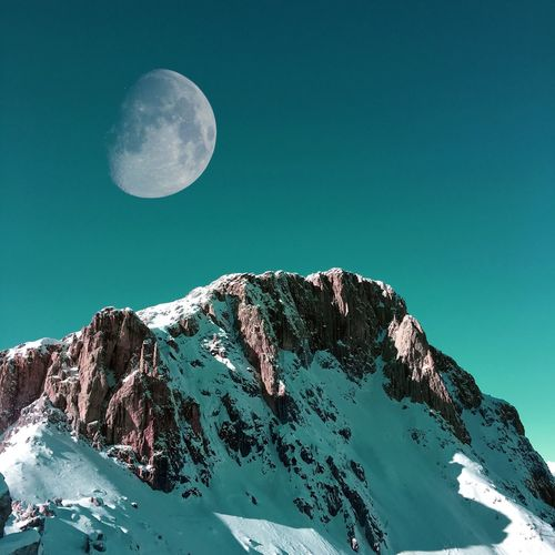 Snowy mountains during full moon