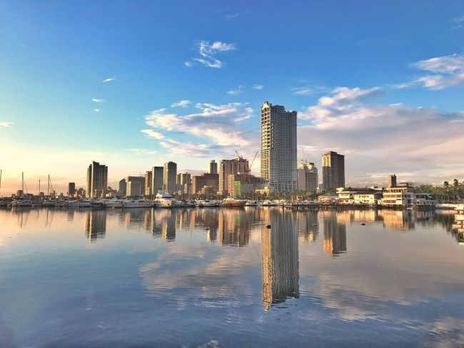 Jaysalvarez Photography Water Sky Architecture Skyscraper Reflection Built Structure Building Exterior City Waterfront Cityscape Urban Skyline Outdoors Blue Cloud - Sky No People Modern Sea Nature Day
