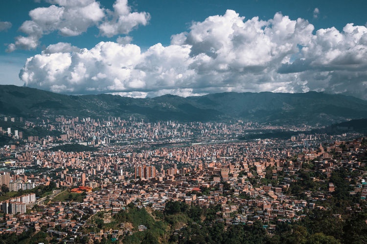 Exploring the city of Medellín. Architecture Building Exterior Built Structure City Nature Outdoors Travel Destinations South America Latin America Explore Urban Sky Cityscape Cloud - Sky Residential District Crowd Building Crowded High Angle View Mountain Day Town Landscape Environment Community TOWNSCAPE Urban Sprawl Settlement