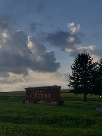 Sign Entrance Name Saint Vincent College Tree Rural Scene Text Sky Grass Cloud - Sky Landscape Dramatic Sky Sunset Moody Sky Romantic Sky Atmospheric Mood Agricultural Field Sky Only Silhouette Sun Farmland
