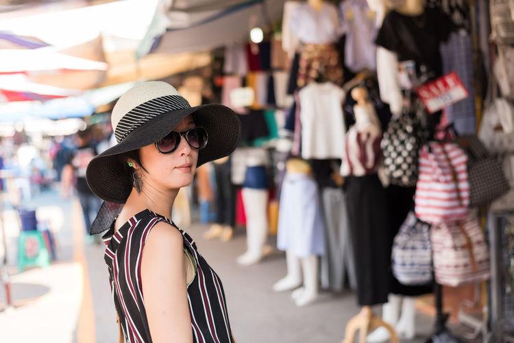 Portrait of woman shopping in market