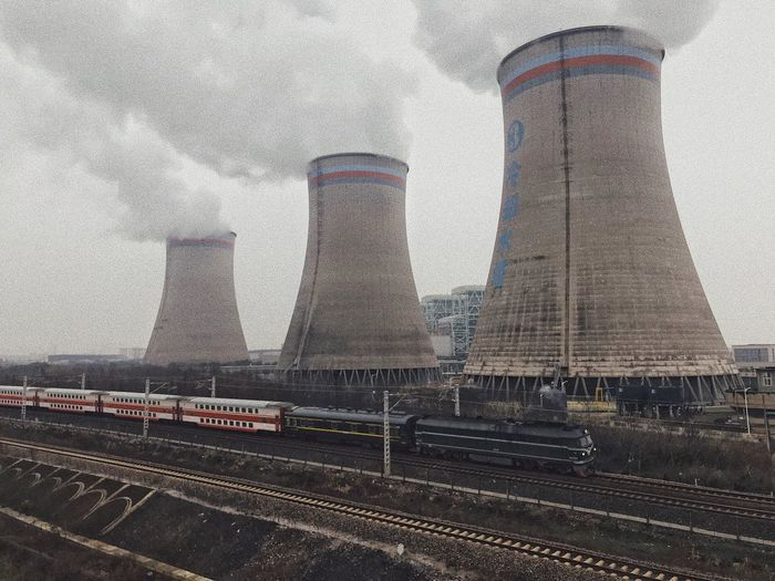 Power Station Smoke Polution Built Structure Architecture Building Exterior Transportation Outdoors Track Industry Travel Tower Sky Train