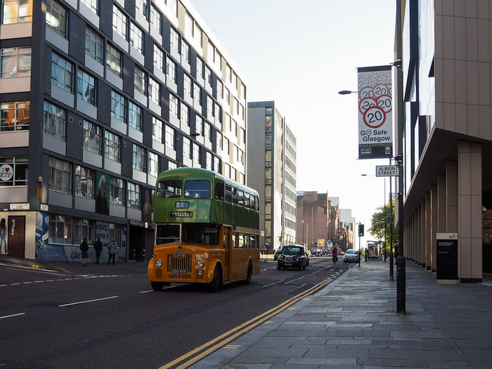 Glasgow  Scotland Architecture Building Exterior Built Structure Bus Car City Communication Day Double Decker Bus Land Vehicle Mode Of Transport Modern No People Outdoors Sky Street Streetphotography Text Transportation