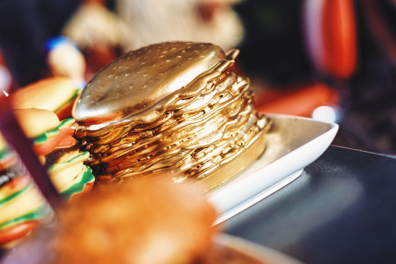 Tilt shot of golden burger on table