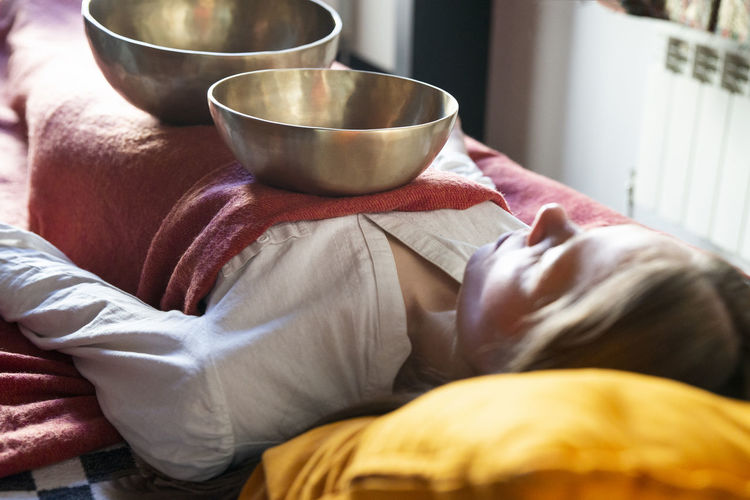 Midsection of woman resting at home