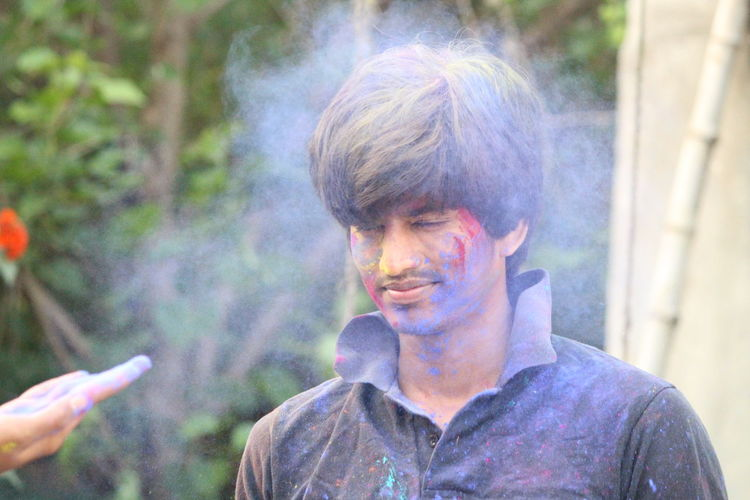Colors Hanging Out Holli Bad Habit Casual Clothing Day Focus On Foreground Front View Headshot Holi Kathir Mano Kathir1020 Leisure Activity Lifestyles Men One Person Outdoors Portrait Real People Smoke - Physical Structure Social Issues Young Adult Young Men