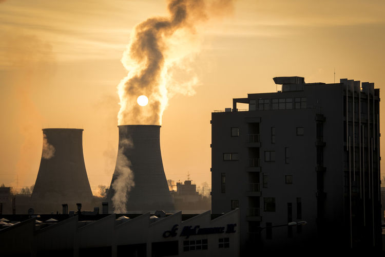 Industrial sunrise Factory Industry Fumes Business Finance And Industry Smoke - Physical Structure Smoke Stack Danger Social Issues RISK Sky