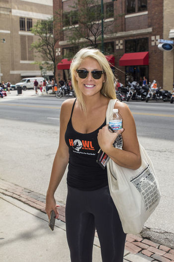 RedBull MotoGP Rally On Meridian Casual Clothing Cleavage Event Goer Events Front View Girl Happiness Incidental People Lifestyles Looking At Camera Person Portrait Smiling Standing Street Sunglasses Young Adult Young Women
