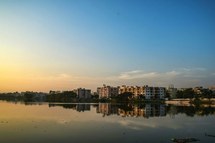 Sunset! Reflection City Water Architecture Lake Cityscape Nature Landscape Silhouette Hyderabad Beauty In Nature Waterfront Sunrise Water Reflections Lake View Landscapes