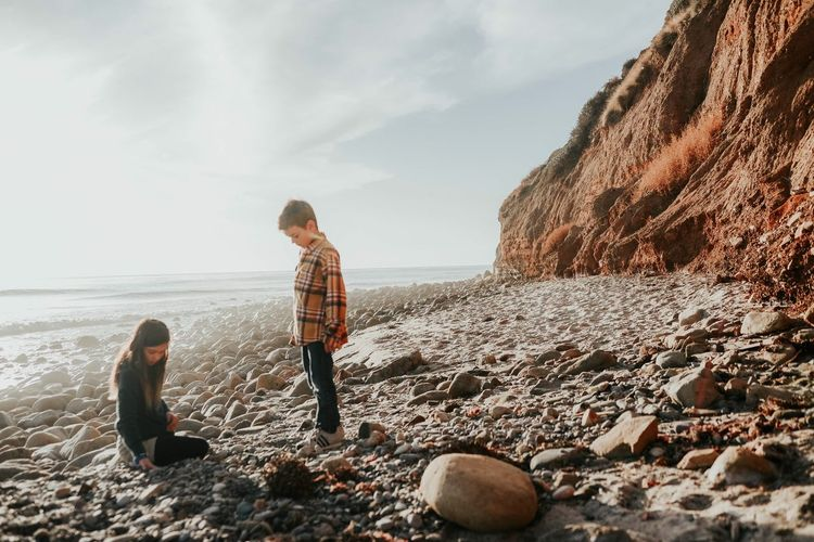 After school adventures Childhood Unplugged Explore More Get Outside Childhoold Brother And Sister Sweet Moments Joy Happiness Wild And Free Sibling Bond Adventure Treasure Hunting Beach Real People Child Childhood Sky Lifestyles Leisure Activity Nature Land Family Rock Beauty In Nature