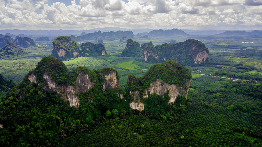 Aerial photo of landscape Mountain Thailand . View Natural Landscape High Nature Water Mountains Outdoor Aerial Background Sun Above Drone  Mountain Beautiful Travel Forest Scenic Blue Summer Green Photo Top Tree Thailand Scenics - Nature Environment Tranquil Scene Beauty In Nature Cloud - Sky Tranquility Sky Plant Non-urban Scene No People Day Green Color Mountain Range Land Idyllic Travel Destinations Outdoors