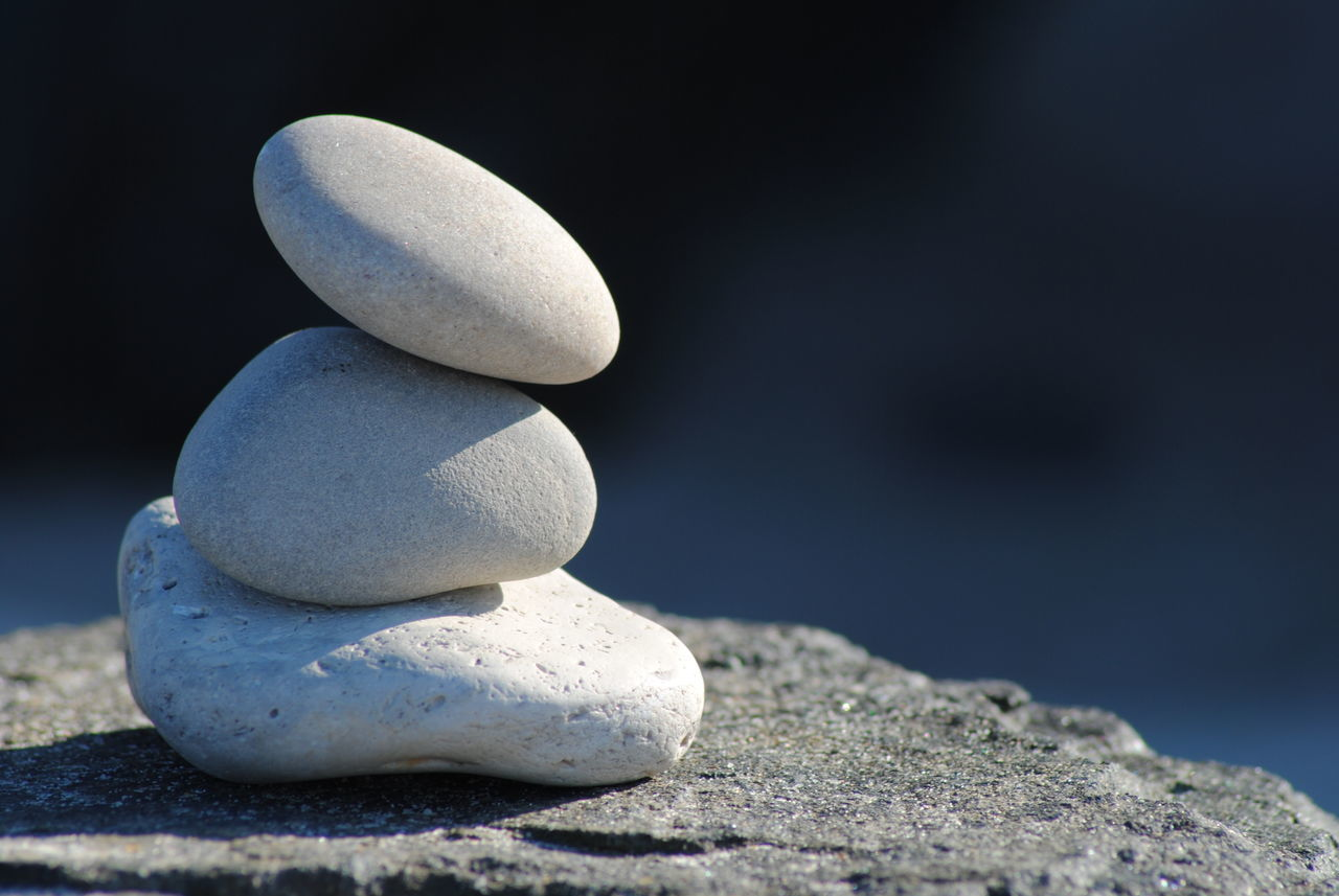 rock - object, stack, still life, no people, balance, pebble, sand, beach, focus on foreground, close-up, sunlight, day, nature, outdoors