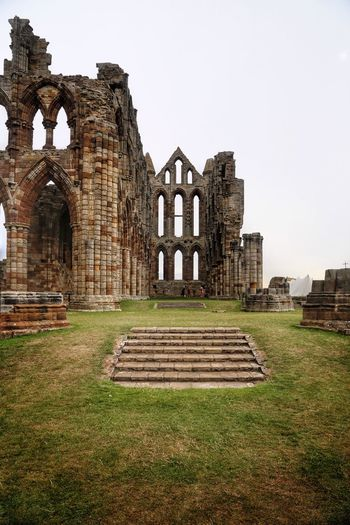 Whitby Whitby Whitby Abbey Architecture History Built Structure The Past Grass Building Exterior Sky Nature Ancient Old Ruin Religion Travel Destinations Old Day Clear Sky Belief No People Travel Place Of Worship Spirituality Outdoors Ruined Ancient Civilization Archaeology Abbey