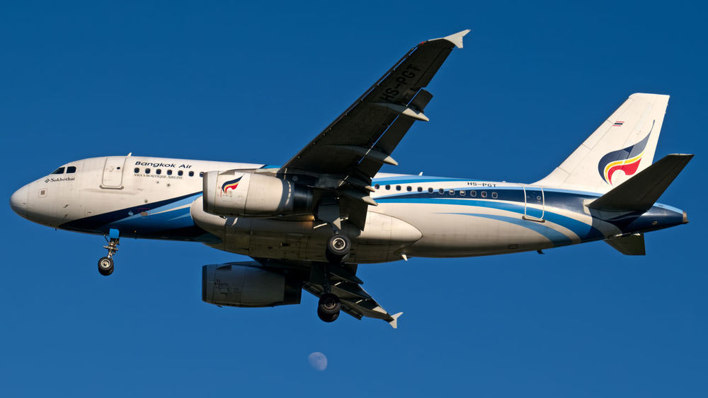 Airbus A319 of Bangkok Airways on short final for runway 36 in Chiang Mai! Airbus Airbus A319 Airplane Airplane & Moon Airways Aviation Photography Bangkok Airways Clear Sky Flying Gear Down Landing Plane Low Angle View Moon On The Move Transportation
