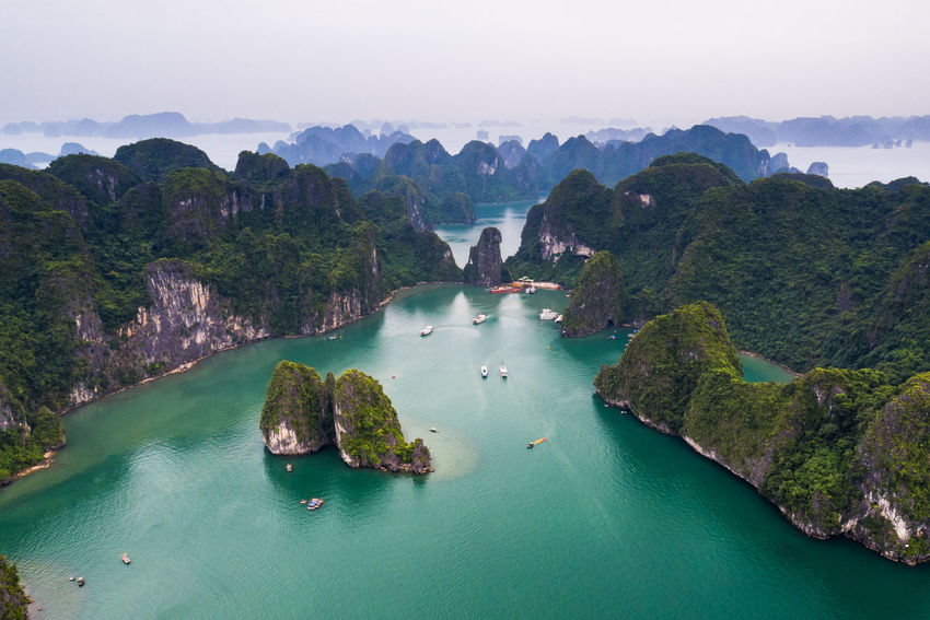 Ha Long Halong Bay Vietnam Halongbay Sung Sot Cave Beauty In Nature Boat Boats Day Ha Long Bay Halong High Angle View Mountain Nature No People Outdoors Physical Geography Rock - Object Scenics Sea Sky Tranquility Tree Water