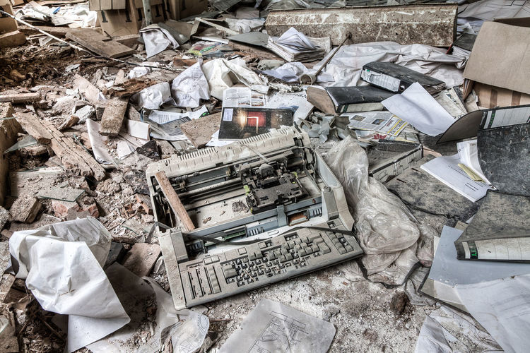 High angle view of abandoned typewriter