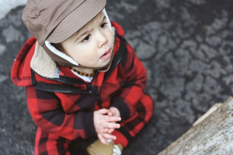 High Angle View Of Toddler Boy Outdoors