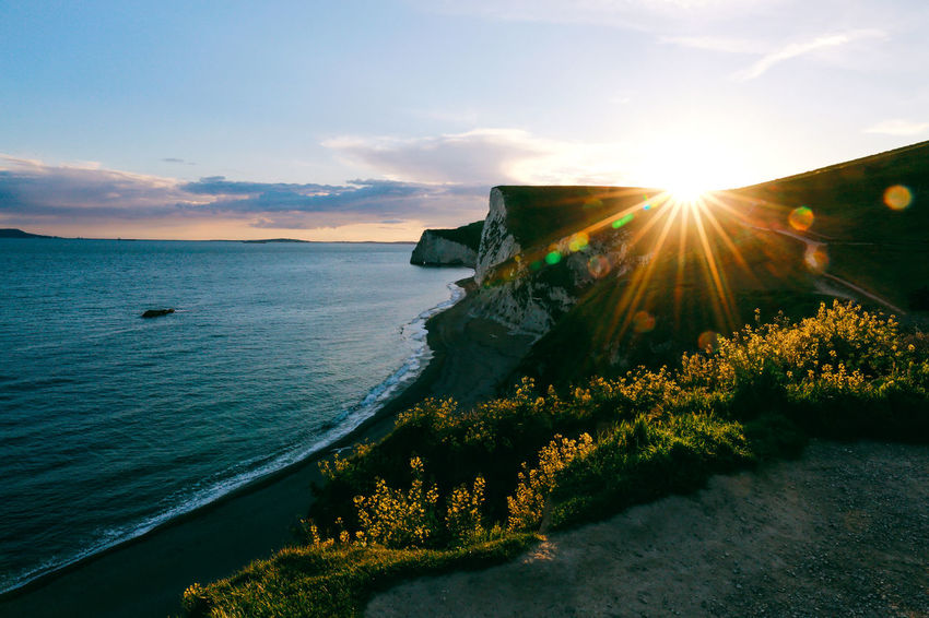 Sun-kissed AONB Beautiful Nature Discovering Dorset Down Durdle Door England Golden Hour Hiking Landscape Lens Flare Rays Of Light Scenics Sea Seascape Sun Sunkissed Sunset Sunset_collection Travel United Kingdom Live For The Story The Great Outdoors - 2017 EyeEm Awards