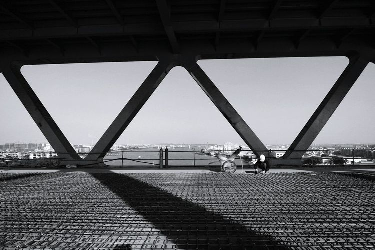 Light And Shadow Construction Construction Site Bridge - Man Made Structure Bridge Real People Skill  Modern One Person One Man Only Occupation Overpass Corridor Silhouette Building Exterior EyeEm Best Shots Blackandwhite Monochrome EyeEm Gallery Bridge - Man Made Structure Built Structure Architecture Outdoors Day Sky City Connection Transportation Below Clear Sky