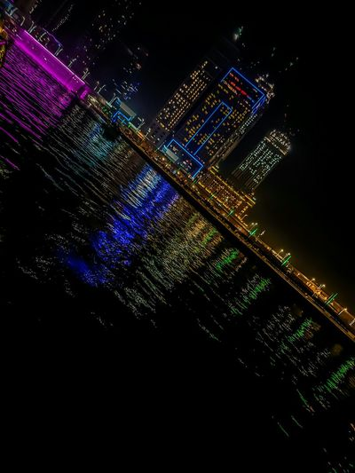 Multi Colored Illuminated Abstract Luminosity Night Backgrounds Futuristic Black Background Outdoors Low Angle View Modern Downtown District Blue UAE Dubai UAE , Dubai Dubai Streetphotography Vacations Travel Destinations Built Structure Water City Reflection Downtown Dubai Dubai Photography