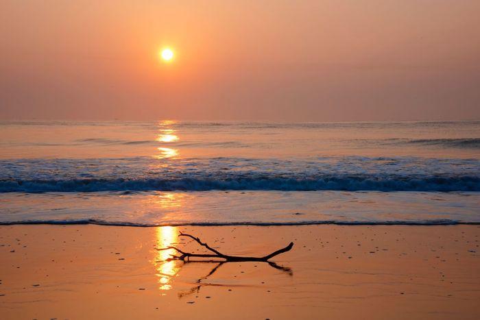 Sunset Sky Water Beauty In Nature Orange Color Scenics - Nature Sea Reflection Sun Tranquility Tranquil Scene Beach Land Idyllic Horizon Horizon Over Water Nature No People Sunlight Outdoors