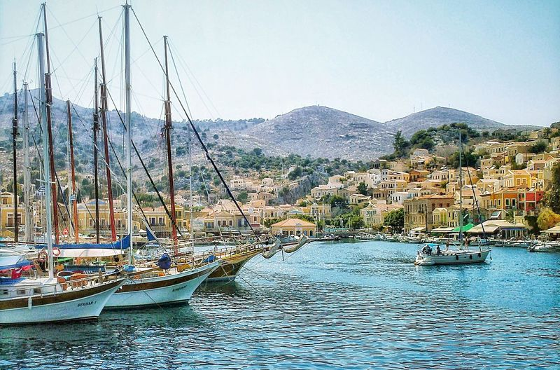 Mountain Nautical Vessel Architecture Transportation Water Day Building Exterior Waterfront Moored Travel Destinations Nature Built Structure Scenics Mountain Range Outdoors Sea No People Clear Sky Harbor Town Boat GREECE ♥♥ The Week On EyeEm Beauty In Nature Blue