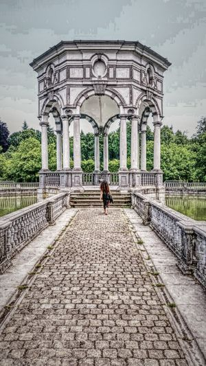 Women walk alone Arch History Architectural Column Architecture Outdoors Day Triumphal Arch