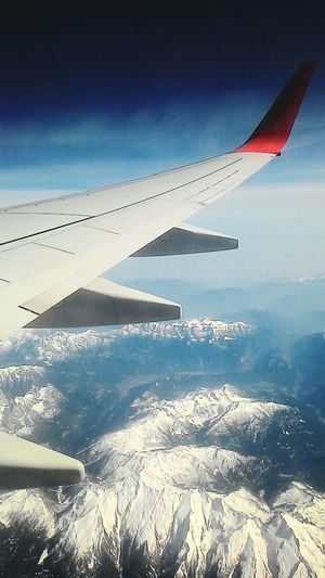 Back home. From An Airplane Window The Alps Traveling Plane Mountains Alps Viewfromtheplane
