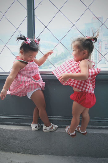 Blowing In the Wind Blowing In The Wind... Childhood Children Only Cutenessoverload Females Full Length Giggles ♥  Girls Niagara Falls Canada Niagara Falls Viewing Tower Togetherness Two People Wind Blown Dresses Wind Blown Hair Windy Live For The Story