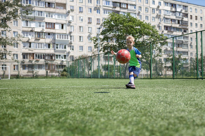 Full length of boy playing with ball